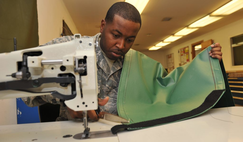 The airforce soldier at the sewing machine